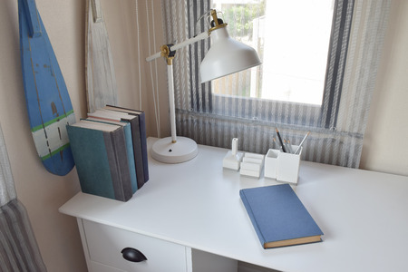 work table: work table with lamp,pencils and books in working room Stock Photo