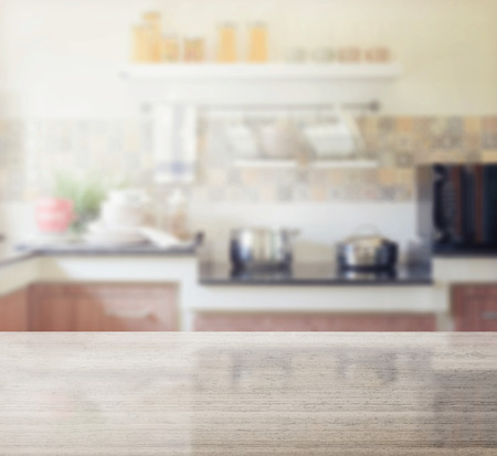 refrigerator with food: granite table top and blur of modern kitchen interior as background Stock Photo