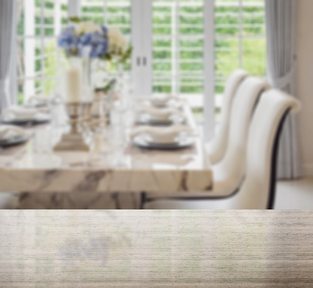 stone worktop: granite table top and blur of dining table and comfortable chairs in vintage style with elegant table setting