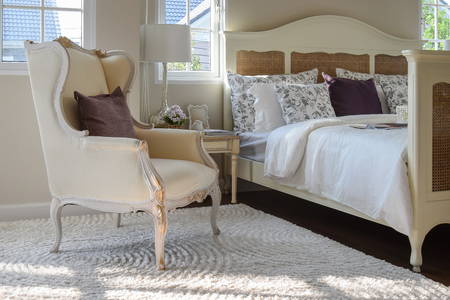 carpet: classic chair with brown pillow on carpet in vintage style bedroom interior Stock Photo