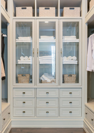 walk in closet: large white walk-in closet with shelves at home
