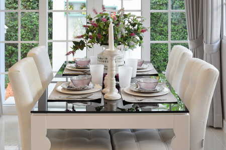 Dining Table And Comfortable Chairs In Vintage Style With Elegant Table  Setting Stock Photo   49212757