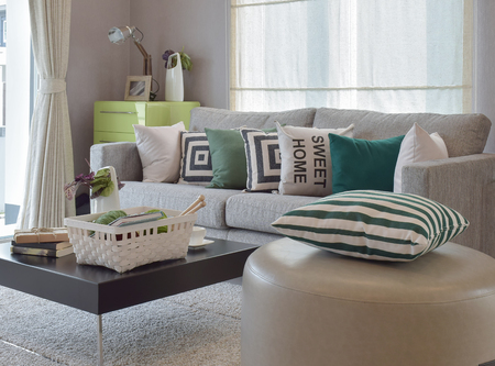 contemporary living room: Knitting set in cozy living room with gray sofa and retro pillows Stock Photo