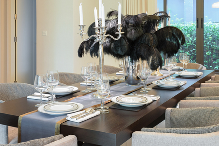 dining room table: dining table and chairs in modern home with elegant table setting Stock Photo