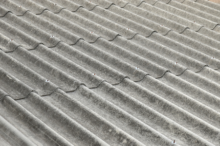 asbestos: closeup of asbestos roof pattern in background Stock Photo