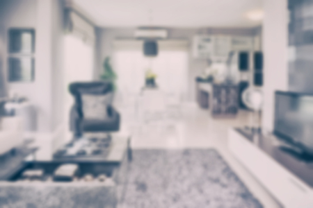 dining room interior: blur image of modern living room interior with dining table and pantry at home Stock Photo