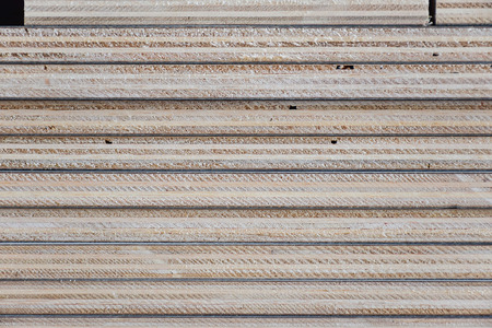 veining: Stack of industrial plywood in construction site for background