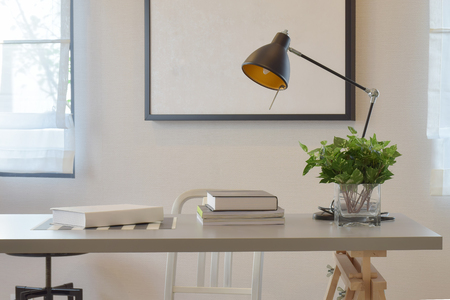 lamp: work table with book lamp, and vase at home Stock Photo