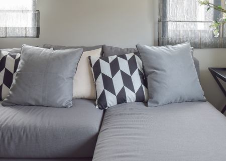 parallelogram: Black and white parallelogram pattern pillows on gray l shape comfy sofa