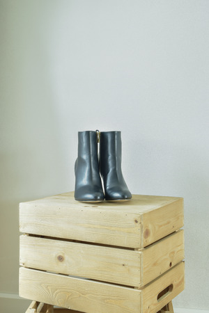 walk in closet: High heel boots on wooden box in walk in closet
