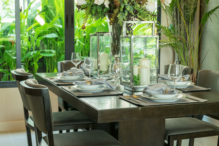 dinning room: table set on wooden table and chairs in tropical dinning room
