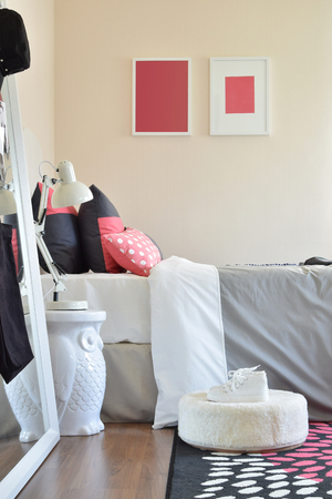 red pillows: modern kids bedroom with red pillows and shoes at home