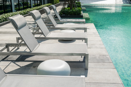 Swimming pool with beach chairs Standard-Bild