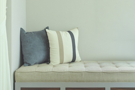 comfy: Pillows on comfy seat in living room
