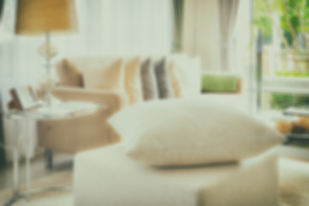 white pillow: blur image of white pillow on stool in modern living room interior Stock Photo