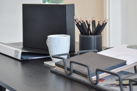 work from home: work table with book,pencils and cup of coffee and in a home Stock Photo