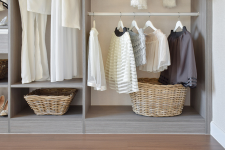 vintage dress: modern closet with row of white dress and shoes hanging in wardrobe