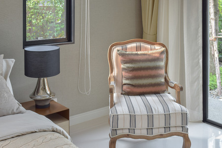 easy chair: Classic style bedding with easy lounge chair in  cozy interior bedroom
