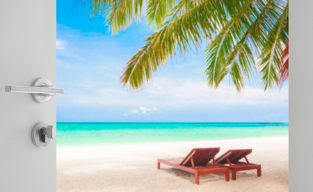 tropical fruits: opened white door to beautiful beach with beach chairs under coconut tree