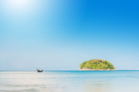 blurred beautiful seascape with blue sea beach island and the long tail boat under clear sky in summer ,kata beach - phuket Stock Photo