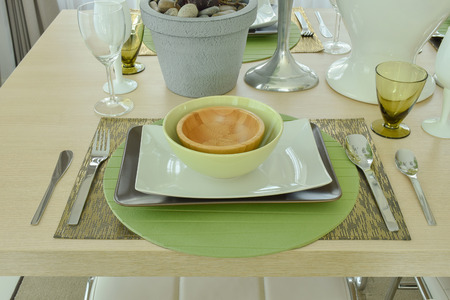 plate setting: Beautiful empty plate setting on wooden dining table Stock Photo