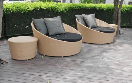 Outdoor artificial rattan on wooden floor