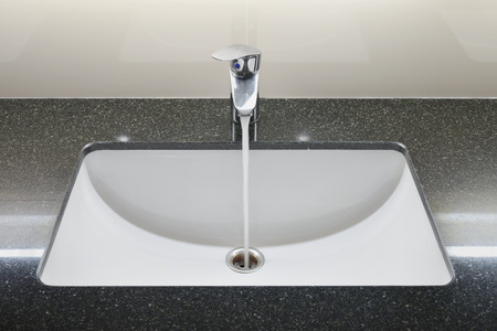 wash basin: Modern style wash basin with faucet Stock Photo