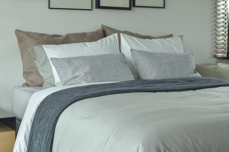 king size bed: Classic color scheme bedding for king size bed Stock Photo