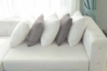 living room sofa: Defocus pillows on sofa in living room Stock Photo