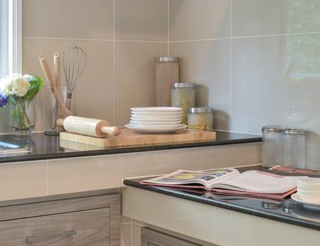 granite kitchen: Bakeware set on the black granite top in modern kitchen Stock Photo