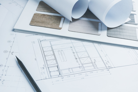 architectural drawings paper with color and material samples for construction