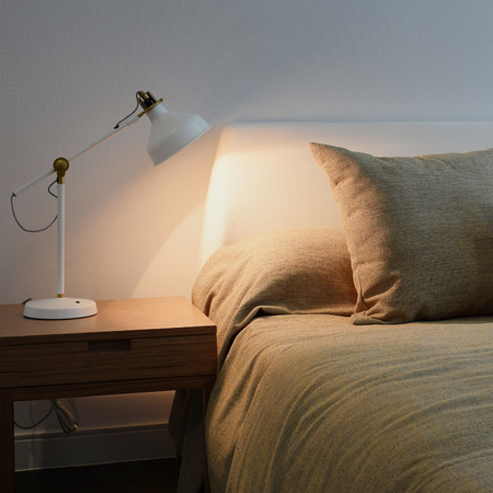 reading lamp: bedroom interior with reading lamp on bedside table