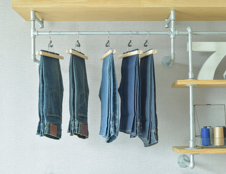 walk in closet: jeans hanging in industrial style walk in closet