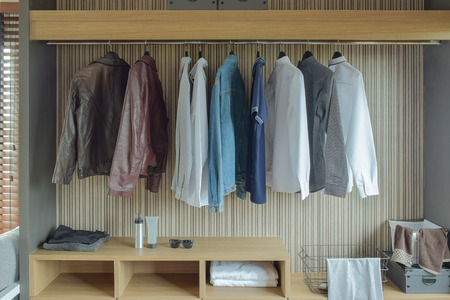 walk in closet: Jackets and shirts in brown color wardrobe