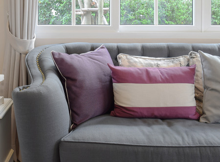 classic living room: luxury living room design with classic sofa and decorative purple pillow