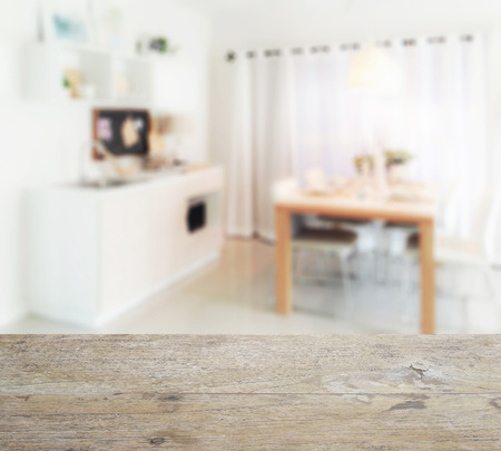 pantry: wooden table top with blur of wooden dining table next to pantry in modern kitchen