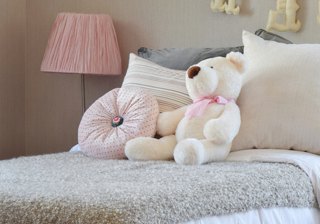 modern doll: modern kids room with doll and pillows on bed