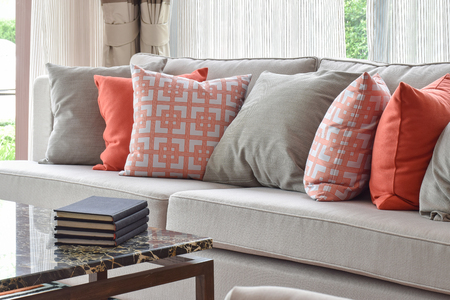 sofa set: Books on marble top table with lively sofa set
