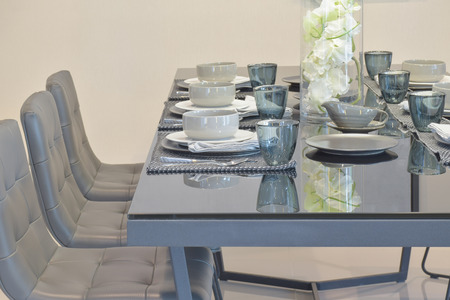 Glass top dining table with modern style dining set in dining room