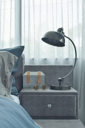 reading lamp: Industrial style reading lamp next to blue color scheme bedding