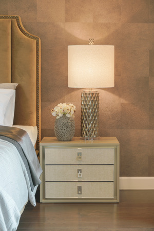 reading lamp: Luxury style reading lamp and flower jar setting on beautiful bedside table next to bed