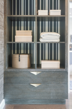 walk in closet: Storage shelf in walk in closet space, modern classic style