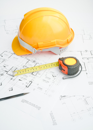 Architects workplace - architectural tools, blueprints, helmet, measuring tape, Construction concept. Engineering tools.
