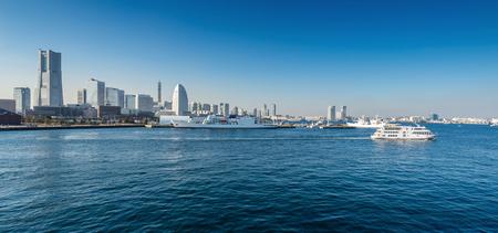 Panoramic view of a port city. Yokohama Minato Mirai 21 Area in Yokohama, Japan viewed from Osanbashi Pier. Stock Photo