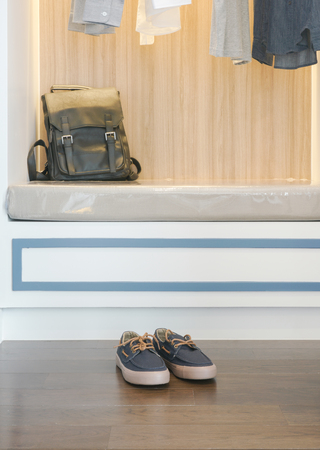 walk in closet: Mens sneaker and leather bag at modern style walk in closet Stock Photo