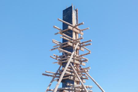 standard steel: Wooden frame preparing for concrete work at construction site