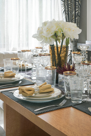 gloden: Elegance style dining set with gloden trim glassware on wooden table