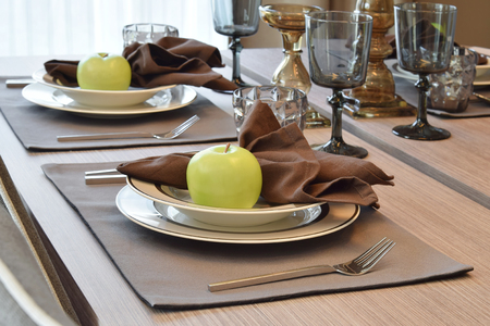 elegant table set in modern style dining room interior Stock Photo