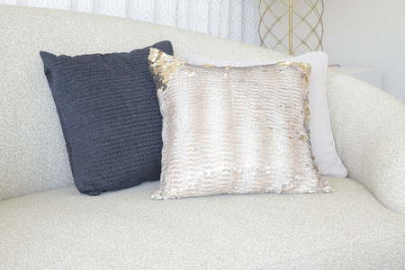 luxury living room: Close up pillows on curve sofa in living room