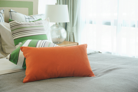 hotel bedroom: Closeup pillows on bed in stylish bedroom interior